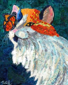 A collage of a calico cat and a monarch butterfly
