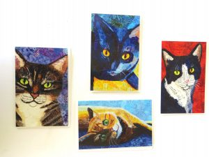 4 cards with cats